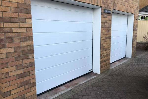 Double white roller garage door