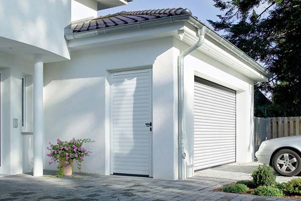 White garage door with side walk in door