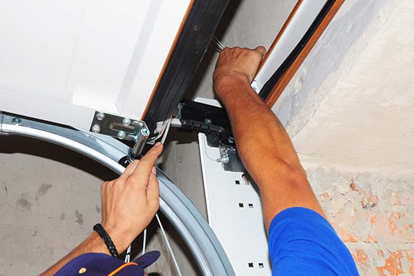 Man fixing an up & over garage door